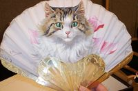 cat fan photographed at a Christie`s auction