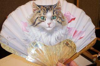 cat fan photographed at a Christie`s auction